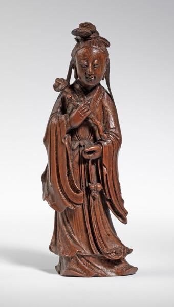 A rare bamboo figure of a female Immortal