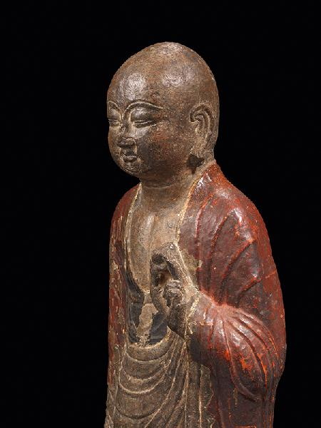 A rare painted limestone figure of a monk