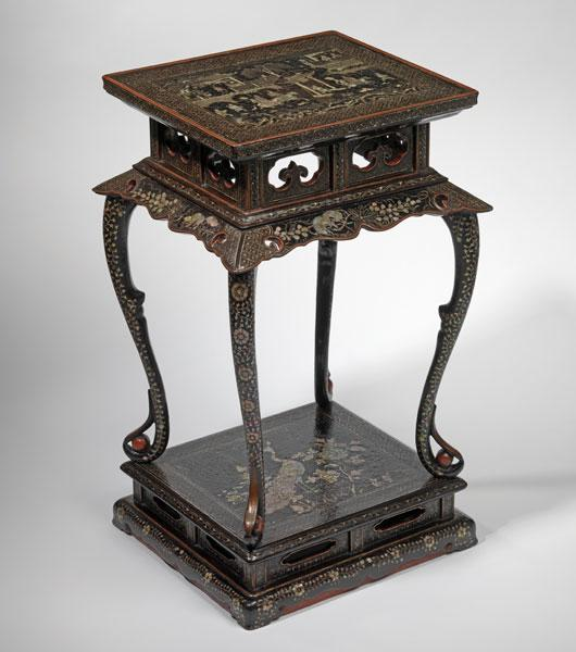 A mother-of-pearl inlaid black lacquer incense stand