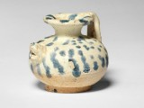 A rare small blue-splashed pottery ewer